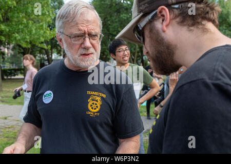 Detroit, Michigan - Green Party Presidential candidate Howie Hawkins talks to people at a rally outside the first night of the Democratic Presidential - Stock Photo