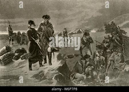 """'Picture of the Camp at Valley Forge, showing military cloak and great coat worn by the officers and the Dutch blankets worn by the private soldiers', c1777, (1937). Valley Forge military encampment for the Continental Army was commanded by General George Washington. Troops spent the winter here from December 19, 1777 to June 19, 1778.  From """"History of American Costume - Book One 1607-1800"""", by Elisabeth McClellan. [Tudor Publishing Company, New York, 1937] - Stock Photo"""