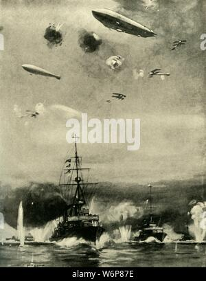 "'The British Air Raid on Cuxhaven, Christmas Day, 1914', (c1920). '...the Zeppelin Attack on the Escorting Force of Light Cruisers'. Depiction 'from the description of an eye-witness', of the British ship-based air-raid on German naval forces at Cuxhaven on the north German coast, during the First World War. From ""The Great World War - A History"" Volume II, edited by Frank A Mumby. [The Gresham Publishing Company Ltd, London, c1920] - Stock Photo"