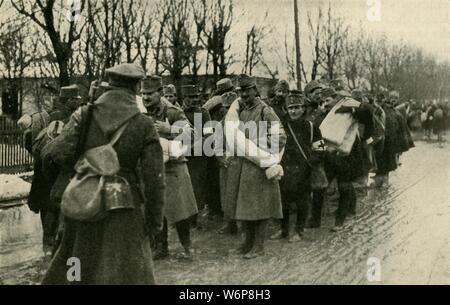 "Austrian prisoners, Przemysl, March 1915, (c1920). 'After the Russian Capture of Przemysl, March 22, 1915: Austrian prisoners preparing for their sixty-mile march to Lemberg'. Austro-Hungarian forces surrendered to the Russians at the fortress of Przemysl (now in south-eastern Poland). From ""The Great World War - A History"" Volume III, edited by Frank A Mumby. [The Gresham Publishing Company Ltd, London, c1920] - Stock Photo"
