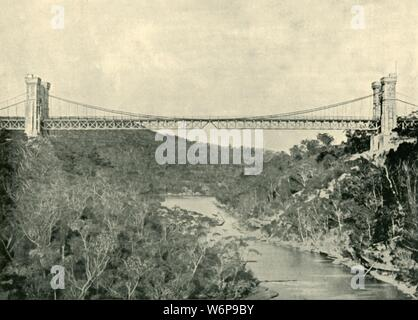 "'Suspension Bridge, North Sydney', 1901. Suspension Bridge known as the Long Gully Bridge, connecting Cammeray and Northbridge a suburb of Sydney over the  Murray River, built in 1889. From ""Federated Australia"". [The Werner Company, London, 1901] - Stock Photo"