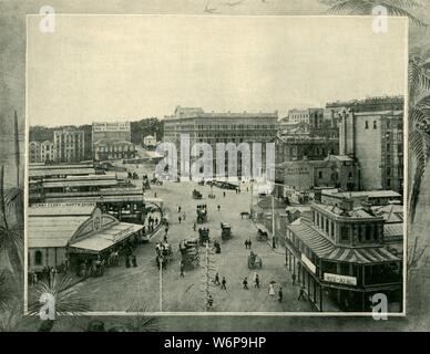 """'Circular Quay, Sydney', 1901. Sydney Cove, on which Circular Quay is located, was the site of initial landing of the First Fleet in Port Jackson on 26 January 1788 and is the main ferry terminal and central point for visitors to the city.  From """"Federated Australia"""". [The Werner Company, London, 1901] - Stock Photo"""