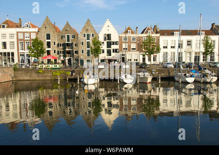 The Kinderdijk and the Spijker Bridge with historic buildings in the city of Middelburg, the Netherlands - Stock Photo