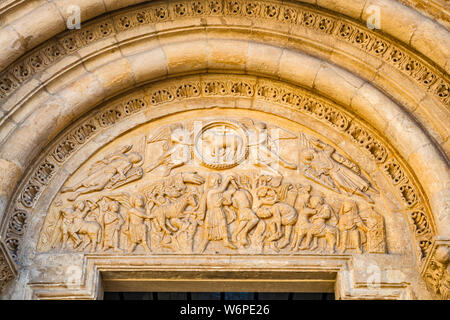 Tympanum at Puerta del Cordero (Gate of the Lamb) at Basilica de San Isidoro in Leon, Castilla y Leon, Spain - Stock Photo