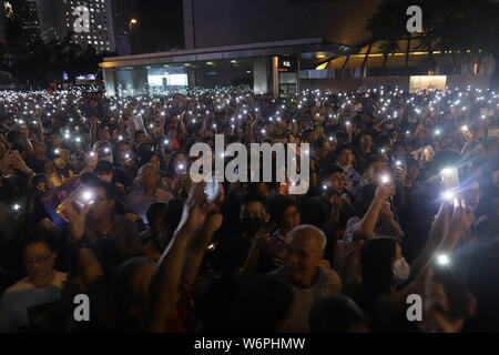 Hong Kong, CHINA. 2nd Aug, 2019. Protesters light up their smartphones as a gesture of protest and solidarity during a mass rally in the financial centre in Central organized by Hong Kong Civil Servants. Credit: Liau Chung-ren/ZUMA Wire/Alamy Live News - Stock Photo