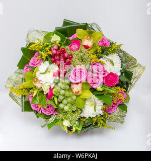 A bouquet of mixed flowers on a white background. - Stock Photo