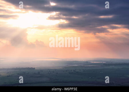 A view of the Golan Heights of Israel at sunset on a cloudy day from Tel Fares near the Syrian border. - Stock Photo