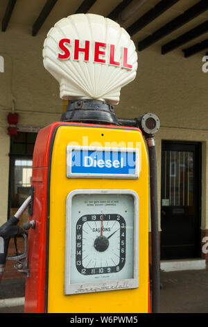 An old classic and obsolete Shell Diesel fuel pump dispensing Premium fuel / vintage 4 star petrol pumps at filling station garage forecourt. UK (110) - Stock Photo