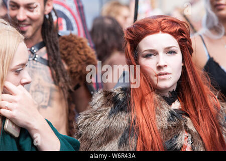 Game of Thrones,characters,character,dressed,up,along High Street,Borth,local.Famous,seaside,resort,village,town,carnival,parade,at,Borth Carnival,held,annually,annual,event,on,the,first,Friday,in,August,every,summer,near,Aberystwyth,Ceredigion,Cardigan Bay,coast,coastline,Mid,Wales,Welsh,festival,UK,GB,Britain,British, - Stock Photo