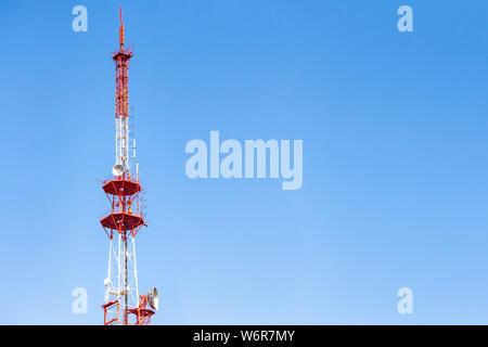 4G TV radio tower with parabolic antenna and satellite dish
