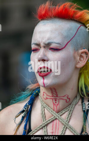 Edinburgh, Scotland, UK. 2nd August, 2019. The fire eating street artist known as Demon Child performing on the Royal Mile at the start of the Edinburgh Fringe Festival. Credit: Skully/Alamy Live News - Stock Photo