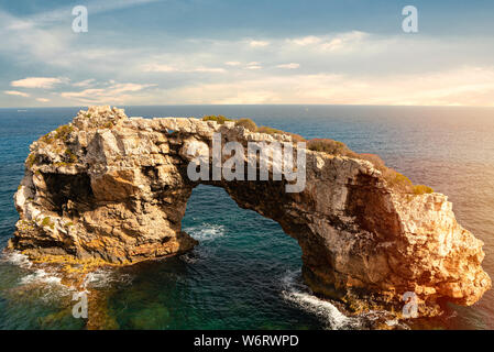 Rocky Arch in the sea, amazing natural wonder. Popular tourist destinations. Mirador Es Pontas, Samtanyi, Palma de Mallorca, Balearic Islands, Spain - Stock Photo