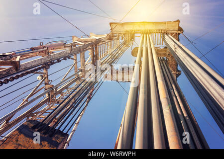 Onshore land rig in oil and gas industry - Stock Photo