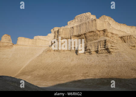 Marl stone formations. Eroded cliffs made of marl, a calcium carbonate-rich, mudstone formed from sedimentary deposits. Photographed in the Dead Sea region of Israel. - Stock Photo