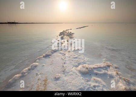 Salt crystallization caused by water evaporation, Dead Sea, Israel. Stock Photo