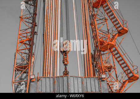 Oil drilling rig operation on the oil platform in oil and gas industry. Industrial concept. Toned.