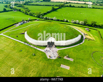 Newgrange, a prehistoric monument built during the Neolithic period, located in County Meath, Ireland. One of the most popular tourist attractions in - Stock Photo