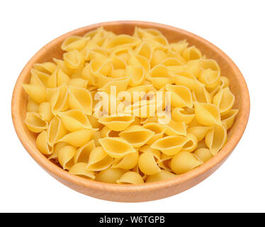 Conchiglie seashell shape pasta in wooden bowl isolated on white background - Stock Photo