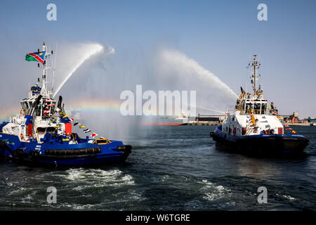 (190802) -- WALVIS BAY (NAMIBIA), Aug. 2, 2019 (Xinhua) -- Fire boats perform during the inauguration ceremony of the new container terminal in Walvis Bay, Namibia, Aug. 2, 2019. Namibia's quest to become an international trade hub and gateway advanced further Friday with the official inauguration of the country's 400-million-U.S.-dollar new container terminal in Walvis Bay by the county's President Hage Geingob. The new container terminal located in the port town of Walvis Bay was constructed on 40 hectares of land reclaimed from the sea by China Harbor Engineering Company Ltd (CHEC) under ju - Stock Photo