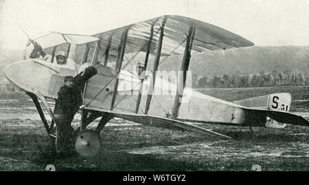 This photo dates to the early 1920s. The caption reads: The Last Word in Fighting Airplanes. This new type of Spad machine shows the propeller mounted between the observer and the pilot, thus giving the observer a clear range in combat instead of the old way of shooting through the propeller. - Stock Photo