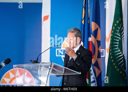 (190802) -- WALVIS BAY (NAMIBIA), Aug. 2, 2019 (Xinhua) -- Zhang Yiming, Chinese Ambassador to Namibia, speaks at the inauguration ceremony of the new container terminal in Walvis Bay, Namibia, Aug. 2, 2019. Namibia's quest to become an international trade hub and gateway advanced further Friday with the official inauguration of the country's 400-million-U.S.-dollar new container terminal in Walvis Bay by the county's President Hage Geingob. The new container terminal located in the port town of Walvis Bay was constructed on 40 hectares of land reclaimed from the sea by China Harbor Engineerin - Stock Photo