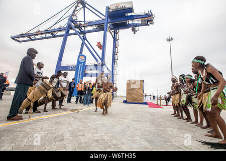 (190802) -- WALVIS BAY (NAMIBIA), Aug. 2, 2019 (Xinhua) -- Local people perform during the inauguration ceremony of the new container terminal in Walvis Bay, Namibia, Aug. 2, 2019. Namibia's quest to become an international trade hub and gateway advanced further Friday with the official inauguration of the country's 400-million-U.S.-dollar new container terminal in Walvis Bay by the county's President Hage Geingob. The new container terminal located in the port town of Walvis Bay was constructed on 40 hectares of land reclaimed from the sea by China Harbor Engineering Company Ltd (CHEC) under - Stock Photo