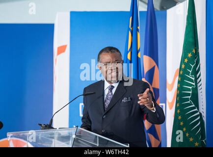 (190802) -- WALVIS BAY (NAMIBIA), Aug. 2, 2019 (Xinhua) -- Namibia's President Hage Geingob delivers a speech at the inauguration ceremony of the new container terminal in Walvis Bay, Namibia, Aug. 2, 2019. Namibia's quest to become an international trade hub and gateway advanced further Friday with the official inauguration of the country's 400-million-U.S.-dollar new container terminal in Walvis Bay by the county's President Hage Geingob. The new container terminal located in the port town of Walvis Bay was constructed on 40 hectares of land reclaimed from the sea by China Harbor Engineering - Stock Photo