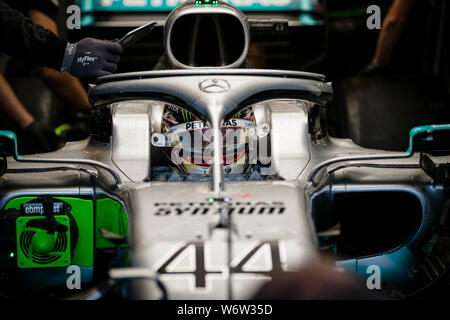 Mercedes AMG Petronas F1 Team's British driver Lewis Hamilton seats in his car during the second practice session of the Hungarian F1 Grand Prix. - Stock Photo