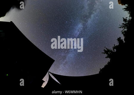 Sablet, The Vaucluse, France. 3rd August 2019. Clear dark skies in southern France show the Milky Way appearing brightly in the night sky. Credit: Malcolm Park/Alamy Live News. - Stock Photo