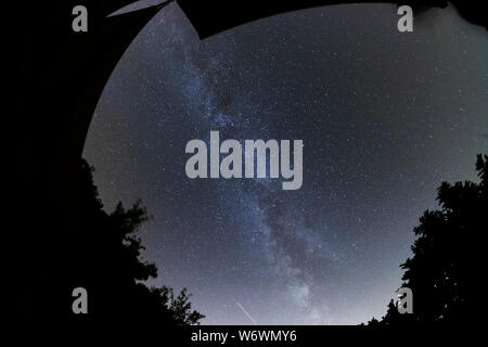Sablet, The Vaucluse, France. 3rd August 2019. Clear dark skies in southern France show the Milky Way appearing brightly in the night sky with a satellite trail at lower edge of the frame. Credit: Malcolm Park/Alamy Live News. - Stock Photo
