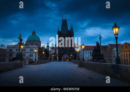 Morning view of Charles Bridge and Old Town Bridge Tower in historical centre of Prague. - Stock Photo