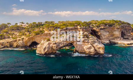 Rocky Arch in the sea, view from sea. Popular tourist destinations. Amazing natural wonder. Mirador Es Pontas, Samtanyi, Mallorca, Balearic Islands - Stock Photo