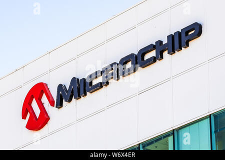 August 1, 2019 San Jose / CA / USA - Microchip sign at their HQ in Silicon Valley; Microchip Technology Inc. manufactures microcontrollers, mixed-sign - Stock Photo