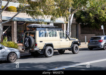 Toytoa landcruiser troopcarrier troopy 78 model in beige parked in a Sydney street but equipped for off road overlanding travel,Australia - Stock Photo