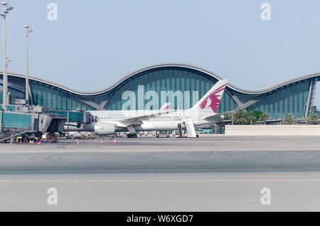 Doha, Qatar, Hamad International Airport, 2018-05-01: Aircraft airline Qatar at the airport. Preparing the aircraft for departure. - Stock Photo