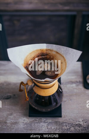 Cup of dripping fresh hot coffee, blended coffee on paper filter - Stock Photo