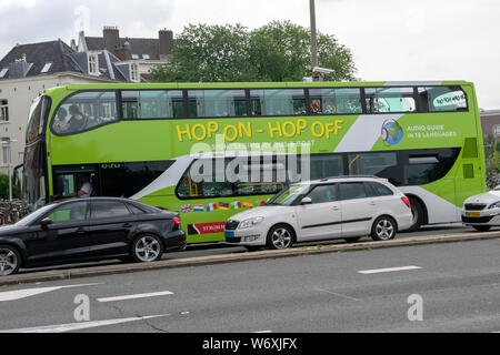 The City Sight Seeing Bus Hop-On And Hop-Of At Amsterdam The Netherlands 2019 - Stock Photo