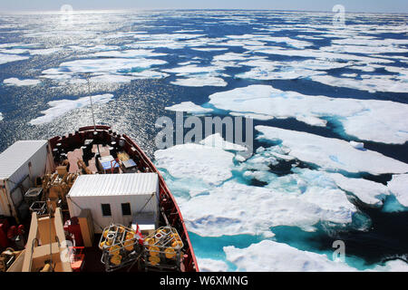 CCGS Amundsen Breaking Through The Ice In The Davis Strait, Canada, Eastern Arctic during an Expedition by ArcticNet and ATLAS EU Scientists - Stock Photo