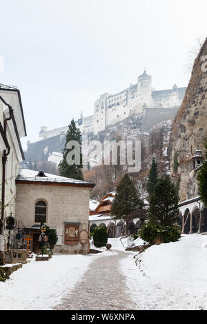 A mid winter view from Salzberg Old Town, Austria looking towards Hohensalzburg Fortress.  The fortress sits atop the Festungsberg a small hill. - Stock Photo