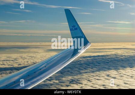 Over Amsterdam. Wing aircraft KLM above the clouds. Amterdam-Helsinki Flight, June 2014 - Stock Photo