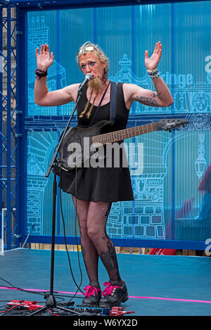 Miss Candy Apple Bottom performing on a stage on the High Street during the Edinburgh Fringe Festival. - Stock Photo