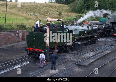 West Country class preserved steam locomotive 34027 Taw Valley in Bridgnorth shed on the Severn Valley railway for coal and water on 1st August 2019. - Stock Photo
