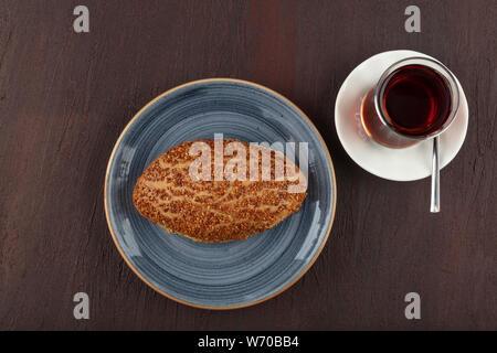 Turkish pastry product , tasty cheese pogaca. Turkish Pastries; pogaca, borek, acma, served on wooden table. - Stock Photo
