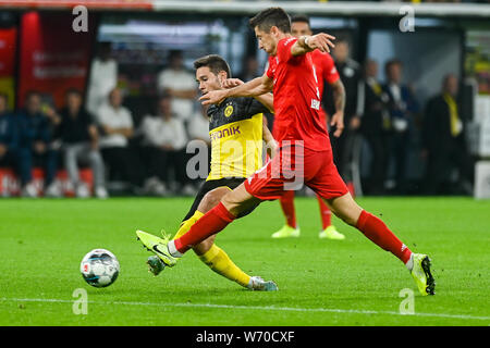 Raphael Guerreiro from Borussia Dortmund (L) and Robert Lewandowski from Bayern Munich (R) are seen in action during the Germany Supercup Final 2019 match between Borussia Dortmund and Bayern Munich.(Final score: Borussia Dortmund 2:0 Bayern Munich) - Stock Photo