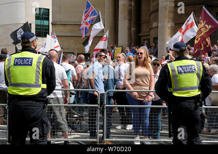 Supporter shout slogans during the rally.Supporters gathered outside BBC to demand the freedom of their jailed right-wing leader Stephen Yaxley-Lennon aka Tommy Robinson. During the rally, police had to intervene and raise their batons when a Police van was attacked by the Tommy Robinson supporters. A person was arrested after the confrontation. - Stock Photo