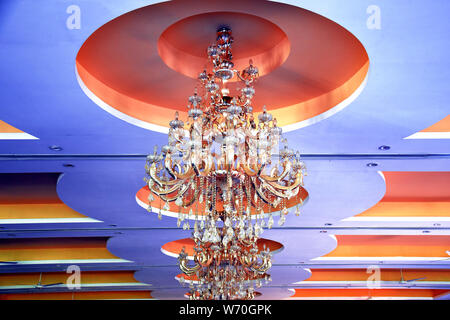 rooftop beautiful chandelier with blue background - Stock Photo
