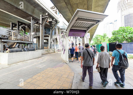 Bangkok , Thailand -  1 August, 2019 : The tourist walking at stair of BTS sky train Taksin station - Stock Photo