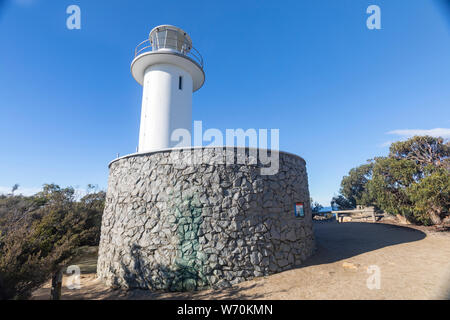 Cape Tourville lighthouse in Freycinet national park on the east coast of Tasmania,Australia on a blue sky winters day - Stock Photo
