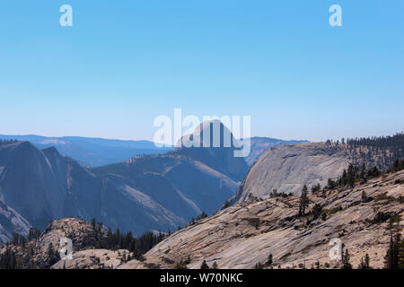 Olmsted Point along the Tioga Road, Yosemite National Park, offers a view into Tenaya Canyon, particularly Half Dome and Tenaya Lake. - Stock Photo