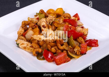 Asian cuisine - Roasted pork with vegetables - Stock Photo